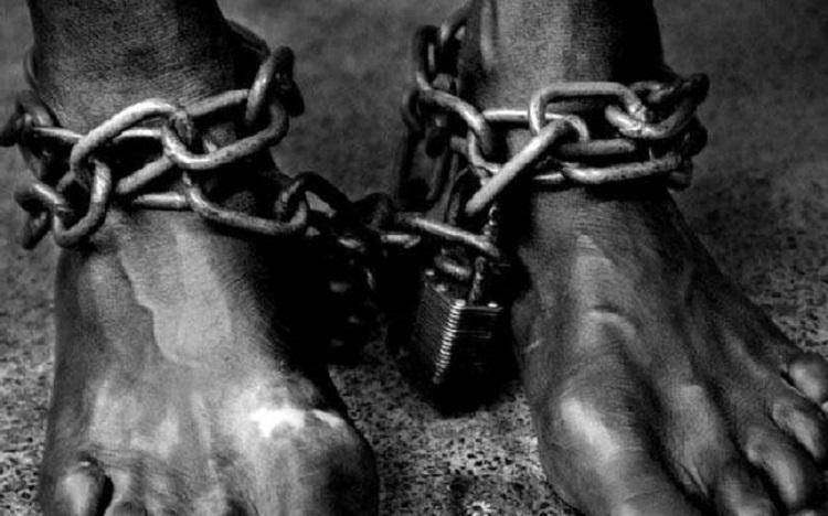 A prisoner in shackles