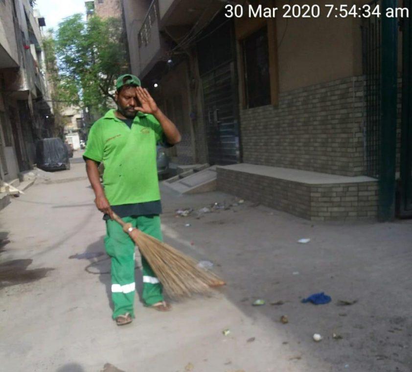 Worker in street cleaning