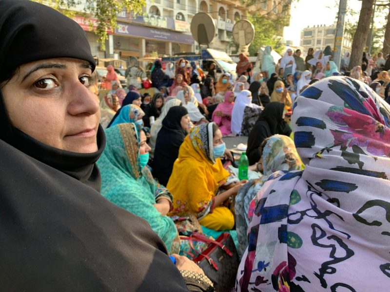 The protesting lady health workers used rugs, plastic bottles and their purses to demarcate the space for the sit-in at D-Chowk